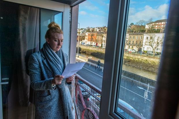 Aimee O'Riordan pictured with her eviction notice at the Leeside Apartments on Bachelor's Quay in Cork City. Photo: Michael Mac Sweeney/Provision