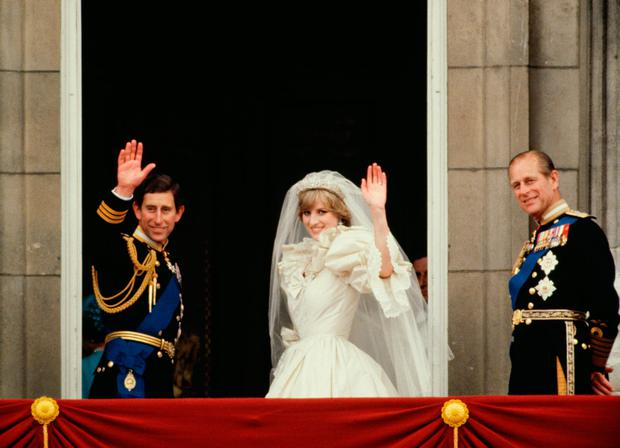 Prince Charles And Princess Diana Waving From The Balcony Of Buckingham Palace. They Are Accompanied By Prince Philip. The Princess Is Wearing A Dress Designed By David And Elizabeth Emanuel. (Photo by Tim Graham/Getty Images)
