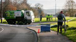 Members of the Gardai at the scene of a fatal collison involving a cyclist and a roadsweeping truck on Whitechurch Road, Dublin. Photo: Gareth Chaney Collins
