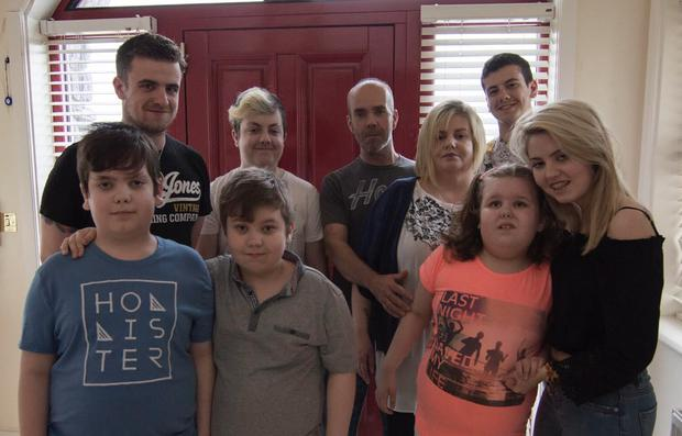 Aine McAuley Crosse with her husband Gerry, and their family. Lisa (front row, second from right), Darragh (front row, far left) and Sean (front row, second from left) all have mitochondria disease.