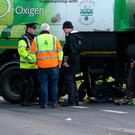 Gardaí at the scene of the fatal collision between a cyclist and a road sweeping truck in Rathfarnham, Dublin. Photo: Steve Humphreys