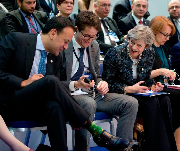 Leo Varadkar shows his socks to British PM Theresa May in Gothenburg. Picture: AP