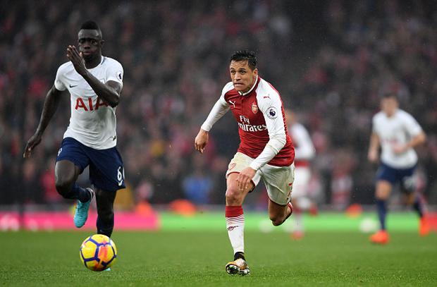 Davinson Sanchez of Tottenham Hotspur and Alexis Sanchez of Arsenal in action during the Premier League match between Arsenal and Tottenham Hotspur at Emirates Stadium on November 18, 2017 in London, England. (Photo by Mike Hewitt/Getty Images)