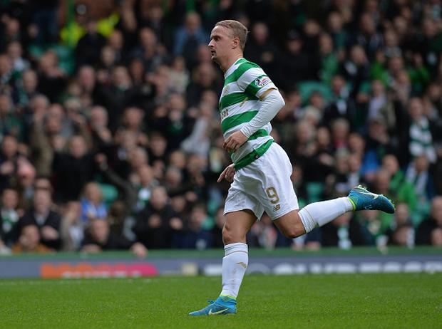 Leigh Griffiths of Celtic celebrates scoring the opening goal of the game during the Ladbrokes Scottish Premiership match between Celtic and Kilmarnock at Celtic Park Stadium on October 28, 2017 in Glasgow, Scotland. (Photo by Mark Runnacles/Getty Images)