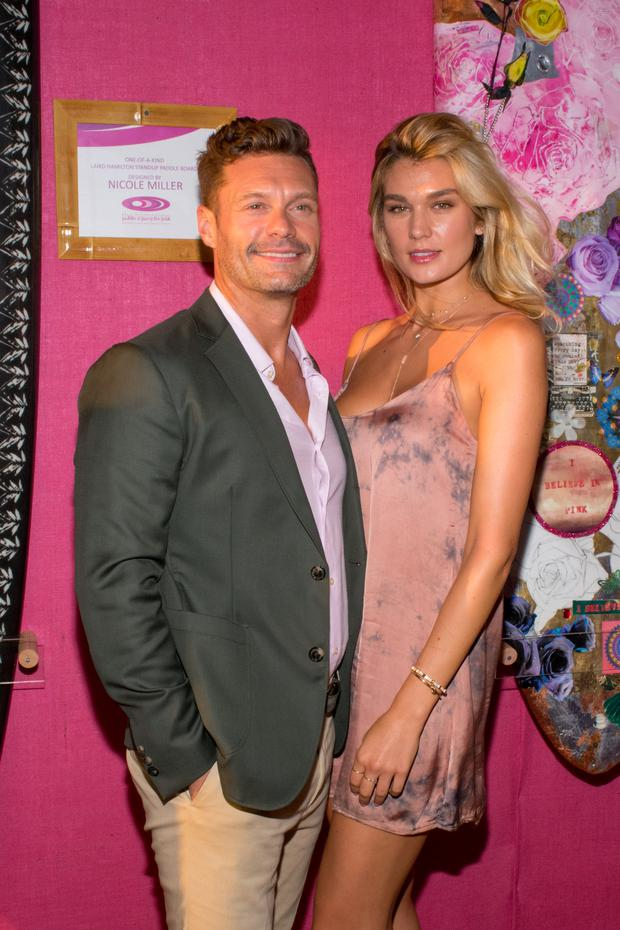 BRIDGEHAMPTON, NY - AUGUST 05: Ryan Seacrest and girlfriend Shayna Taylor attend the Sixth Annual Hamptons Paddle & Party For Pink To Benefit Breast Cancer Research Foundation on August 5, 2017 in Bridgehampton, New York. (Photo by Steven Henry/Getty Images for Breast Cancer Research Foundation)