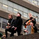 Kodaline and Glen Hansard performing at Apollo House in Dublin City centre during protests there. Photo: Gerry Mooney