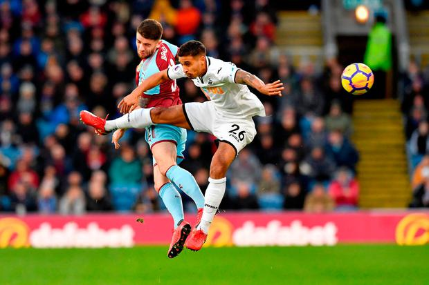 Burnley's Robbie Brady and Swansea City's Kyle Naughton (right) compete for a header during the Premier League match at Turf Moor, Burnley. PRESS ASSOCIATION Photo. Picture date: Saturday November 18, 2017. See PA story SOCCER Burnley. Photo credit should read: Anthony Devlin/PA Wire