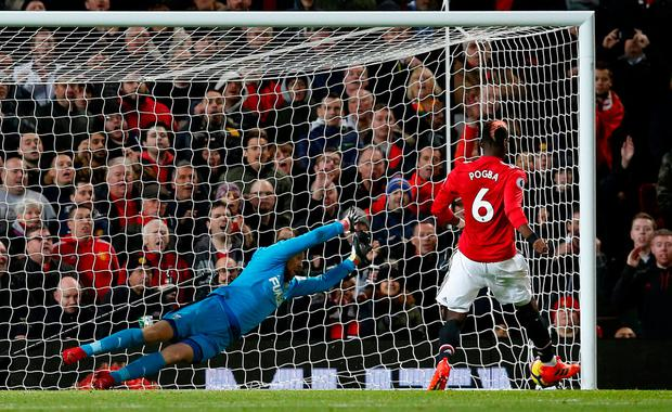Soccer Football - Premier League - Manchester United vs Newcastle United - Old Trafford, Manchester, Britain - November 18, 2017 Manchester United's Paul Pogba scores their third goal. REUTERS/Andrew Yates