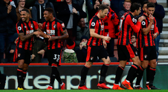 Callum Wilson (1st L) of AFC Bournemouth celebrates scoring his side's second goal with his team mates. Photo: Getty Images