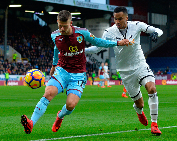 Johann Berg Gudmundsson of Burnley is tackled by Martin Olsson of Swansea City. Photo: Getty Images