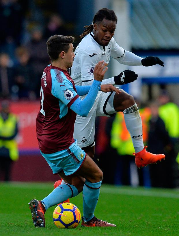 Matthew Lowton of Burnley and Renato Sanches of Swansea City challenge. Photo: Getty Images