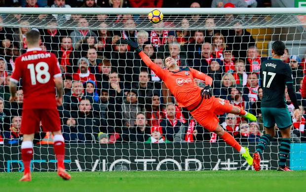 Liverpool's Mohamed Salah (not pictured) scores their first goal Photo: Reuters/Jason Cairnduff
