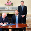 CIVIL SERVANTS: Martin Fraser behind President Michael D Higgins and Taoiseach Leo Varadkar in Aras An Uachtarain
