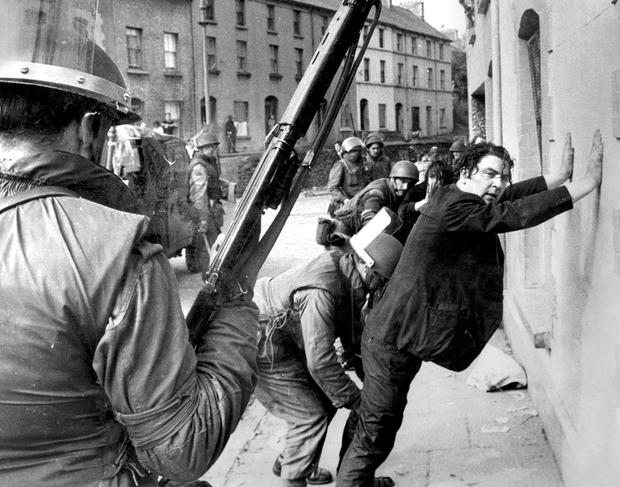 MAKING A STAND: John Hume is detained by soldiers during a civil rights protest in Derry in 1971.