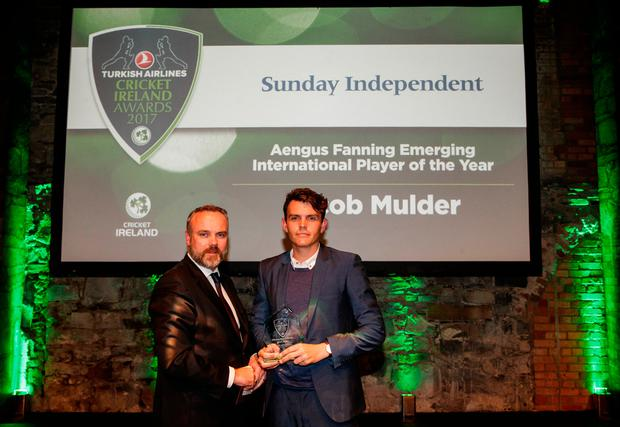 Sunday Independent Editor Cormac Bourke presents the Aengus Fanning International Emerging Player of the Year award to Jacob Mulder Photo: INPHO/Ryan Byrne