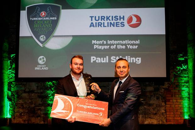Paul Stirling accepts his Men's International Player of the Year award from Hasan Mutlu, General Manager Turkish Airlines Ireland, at the Cricket Ireland presentation in Smock Alley on Friday night Photo: INPHO/Ryan Byrne