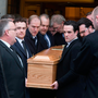 Mourners carry the coffin from the church at Peter Mathew's funeral. Photo: Colin O'Riordan