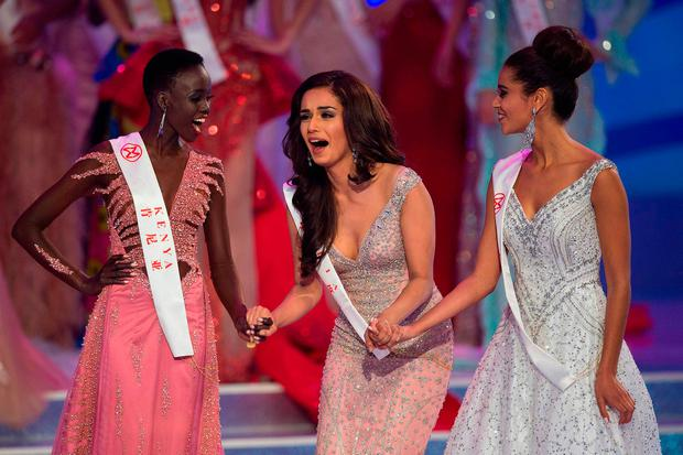 Miss India Manushi Chhilar (C) reacts as she wins the 67th Miss World contest final next to France Aurore Andrée Raphaëlle Kichenin (R) and Miss Kenya Magline Jeruto (L) in Sanya, on the tropical Chinese island of Hainan on November 18, 2017. / AFP PHOTO / NICOLAS ASFOURINICOLAS ASFOURI/AFP/Getty Images