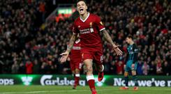 Philippe Coutinho of Liverpool celebrates scoring his side's third goal during the Premier League match between Liverpool and Southampton at Anfield on November 18, 2017 in Liverpool, England. (Photo by Jan Kruger/Getty Images)