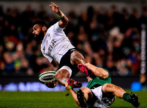 Fiji's Nikola Matawalu is tackled to the ground by Andrew Conway. Photo: Sam Barnes/Sportsfile