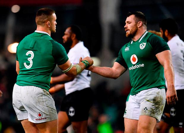 Andrew Porter, left, and Cian Healy celebrate at the end of the game. Photo: Sam Barnes/Sportsfile