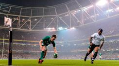 Darren Sweetnam goes over to touch down for Ireland's first try against Fiji at the Aviva Stadium. Photo: EÓIN NOONAN/SPORTSFILE