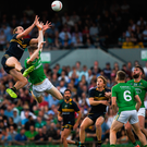 Nat Fyfe springs into action to make the mark for Australia ahead of Ireland's Kevin Feely during Saturday's second Test in Perth. Photo: Sportsfile