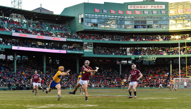 Johnny Coen of Galway has a shot on goal despite the best efforts of David McInerney of Clare during the AIG Super 11's Fenway Classic Final match between Clare and Galway at Fenway Park in Boston, MA, USA. Photo by Brendan Moran/Sportsfile