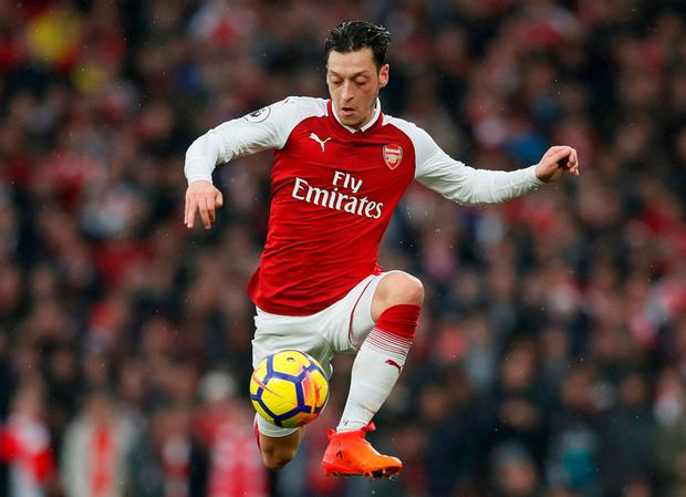 Mesut Ozil takes control of the action during Saturday's derby against Tottenham. Photo: REUTERS