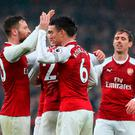 Arsenal's Shkodran Mustafi (left) and Laurent Koscielny celebrate victory with their team-mates at full time in the North London derby. Photo: PA