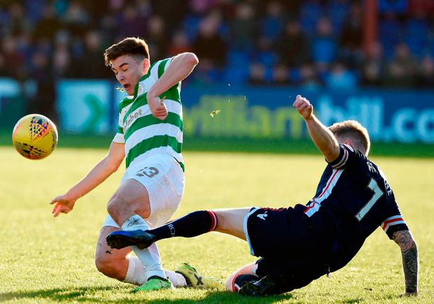 Celtic's Kieran Tierney and Ross County's Michael Garden collide. Photo: PA