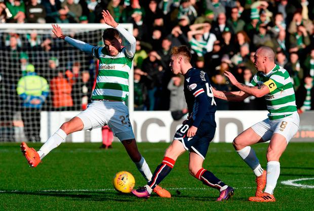 Celtic's Michael Lustig (left), tackles Ross County's Davis Keillor-Dun. Photo: PA