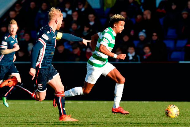 Celtic's Scott Sinclair goes on a run with Ross County's Andrew Davies in pursuit. Photo: PA