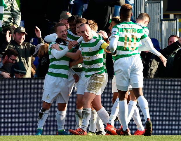 Leigh Griffiths (left) celebrates with Dedryck Boyata, Kieran Tierney and Scott Brown after scoring Celtic's winning goal. Photo: PA