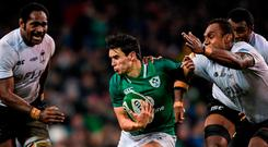 Ireland's Joey Carbery is tackled by Leone Nakarawa of Fiji. The Leinster star was later forced off with a suspected broken arm. Photo: EÓIN NOONAN/SPORTSFILE