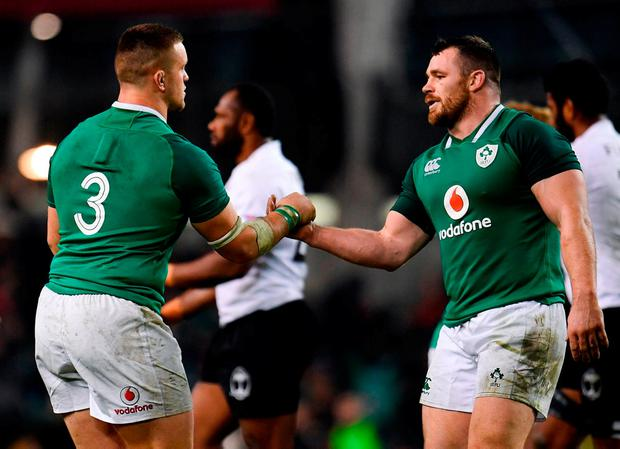 Andrew Porter, left, and Cian Healy celebrate at the final whistle. Photo: Sam Barnes/Sportsfile