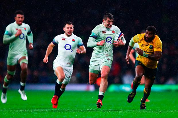 Jonny May of England runs at the Australia defence. Photo: Clive Rose/Getty Images