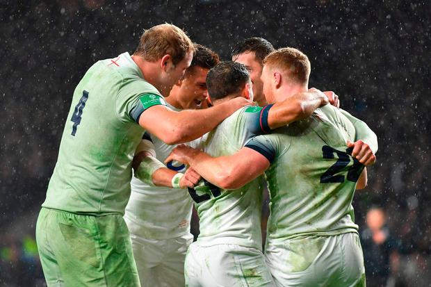 England's wing Jonny May celebrates with teammates after scoring his try. Photo: AFP/Getty Images