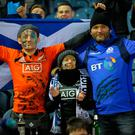 Scottish fans cheer after the international rugby union test match between Scotland and New Zealand at Murrayfield in Edinburgh. Photo: AFP/Getty Images