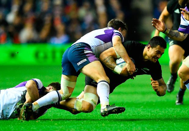 New Zealand's flanker Vaea Fifita (R) is brought down. Photo: AFP/Getty Images