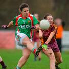 Carnacon's Martha Carter gets her shot away despite the best efforts of Slaine McCarroll of St Macartan's at Fr. Hackett Park in Augher. Photo: Sportsfile
