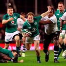Ireland's Kieran Marmion breaks away from Fiji's Leone Nakarawa at the Aviva Stadium on Saturday. Photo: PA