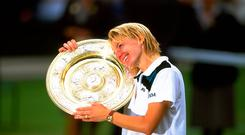 Jana Novotna of the Czech Republic poses with the trophy after the 1998 Wimbledon Championships