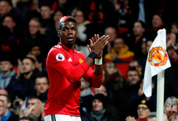 Manchester United's Paul Pogba applauds the fans as he is substituted