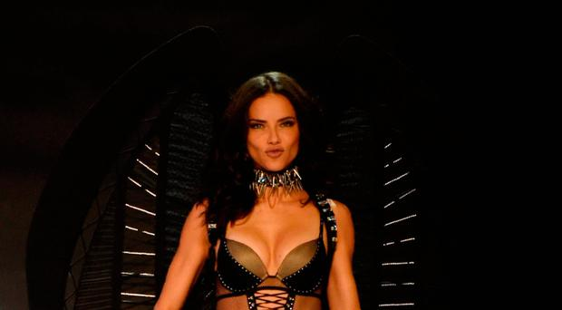 Brazilian model Adriana Lima presents a creation during the 2017 Victoria's Secret Fashion Show in Shanghai on November 20, 2017. / AFP PHOTO / Fred Dufour