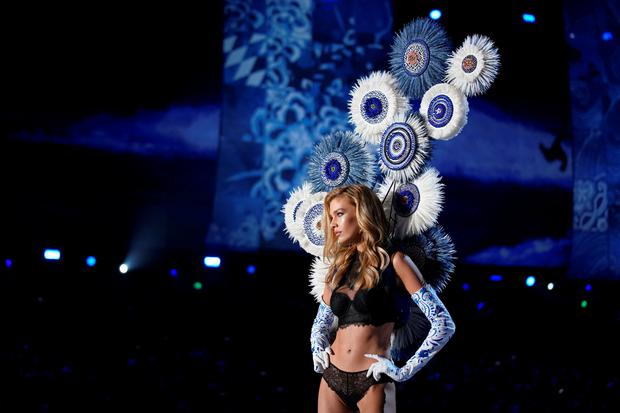 Victoria's Secret model falls on runway in front of millions