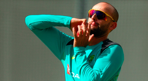 Australia's Nathan Lyon bowls during a nets session yesterday. Photo: Getty Images