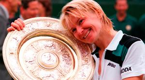 Novotna in a happy mood on Centre Court after winning the 1998 final. Photo: PA Wire