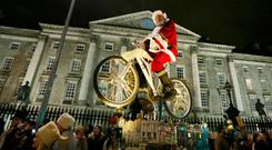 Santa Claus takes part in a parade through Dublin to switch on one million festive lights erected by DublinTown and Dublin City Council. Photo: Leon Farrell