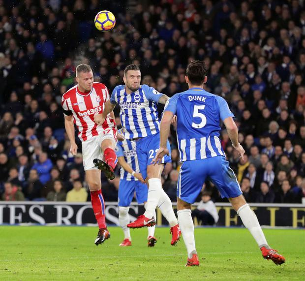 Shane Duffy battles it out with Stoke's Ryan Shawcross during last night's match at the AMEX Stadium. Photo: Gareth Fuller/PA Wire